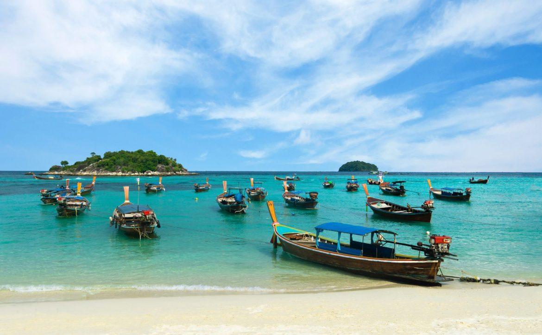 Many long-tailed boat on Sunrise Beach, Koh LIPE, Thailand