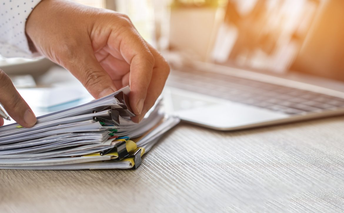 Accountant hand use calculate financial report, counting on calc